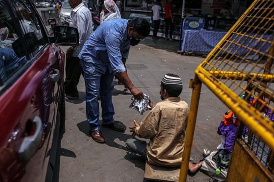 Hunger Crisis Forces Even Middle-Class Indians to Line Up for Rations