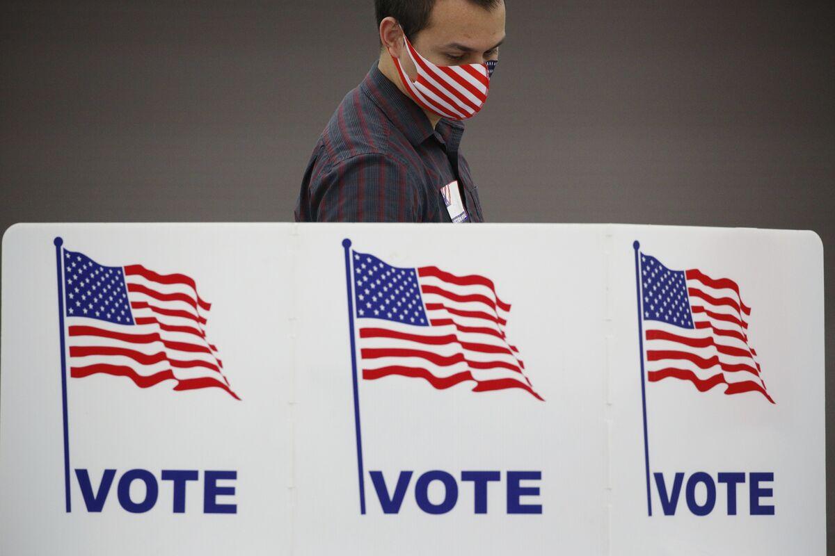 Biden Order Attempts to Blunt GOP Efforts to Restrict Voting