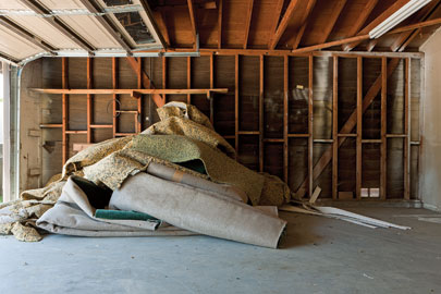 Old carpeting in the garage of a repossessed house in Corona