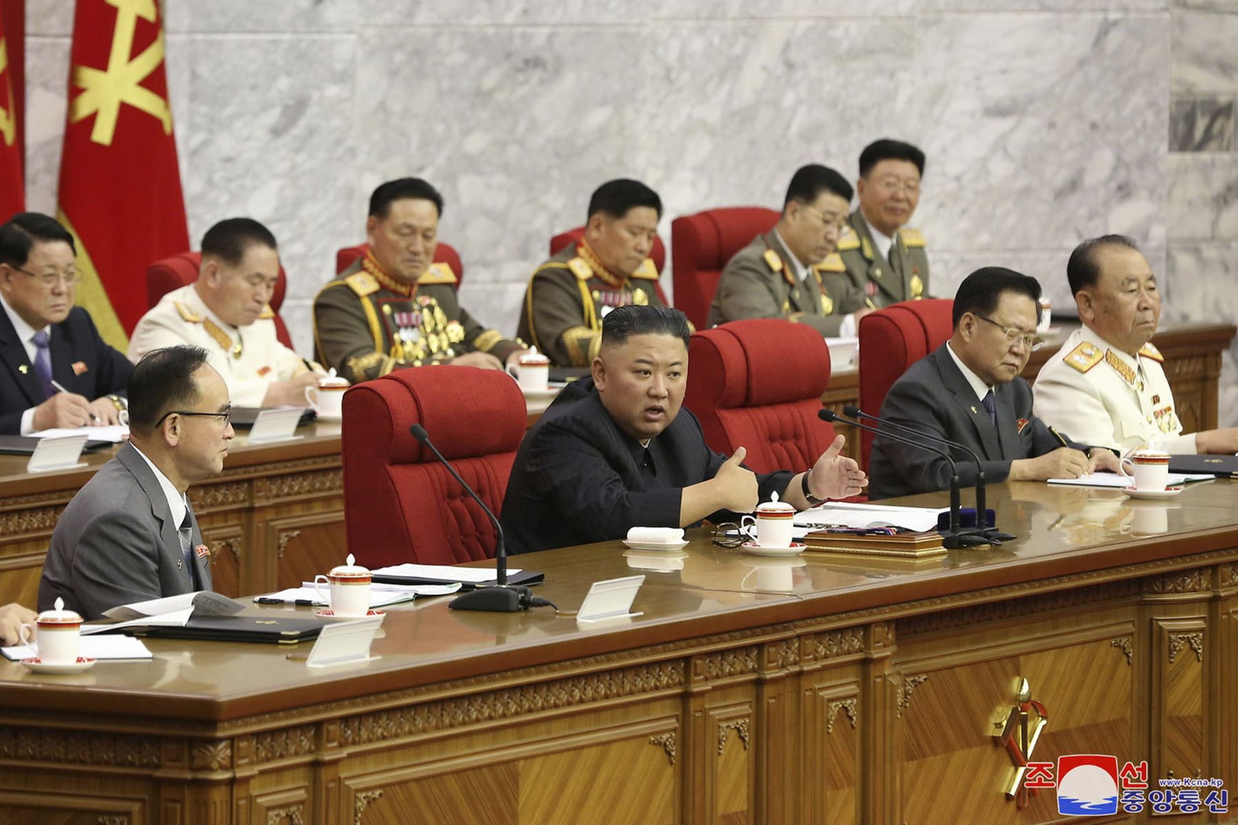 Kim Jong Un, center, speaks during a Workers' Party meeting in Pyongyang on June 17.