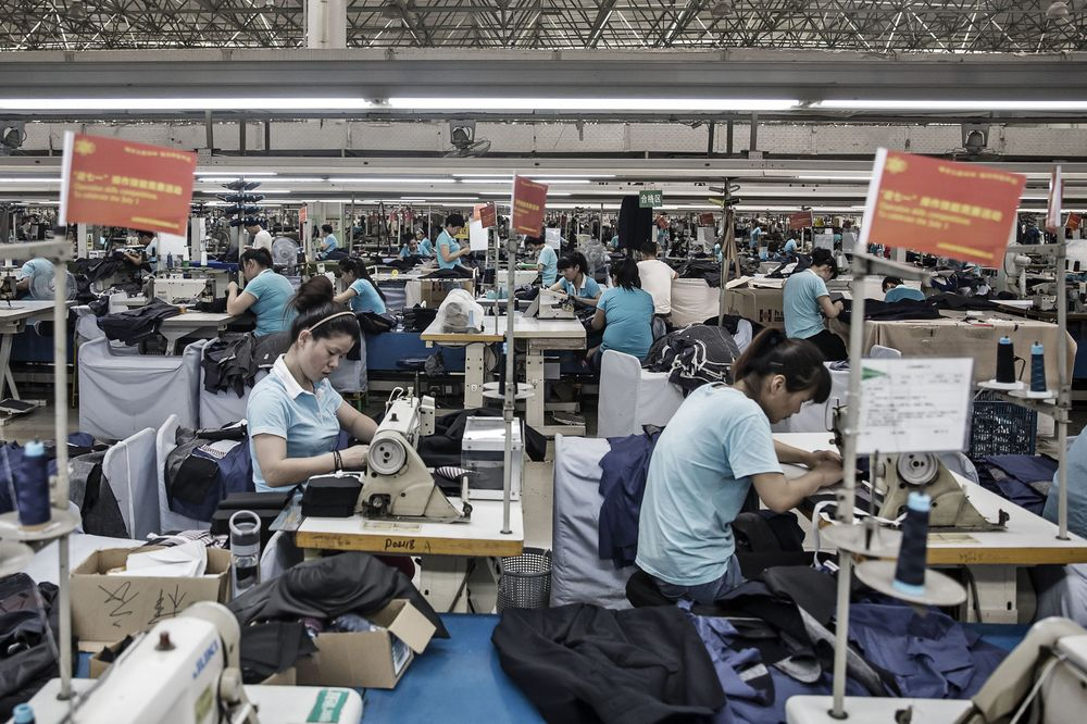 Employees make suits at a factory operated by the Shandong Ruyi Technology Group in Jining, China in 2016.