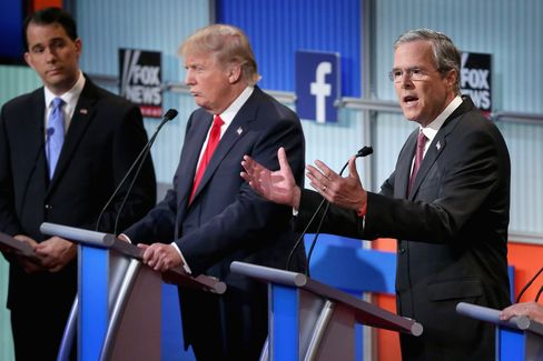 Walker, Trump, and Bush during the first prime-time presidential debate in Cleveland on Aug. 6.