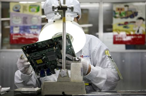 A Foxconn employee on the assembly line