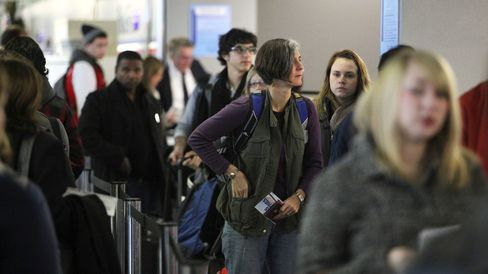 Travelers wait in a security line at Chicago's O'Hare International Airport in November 2010.