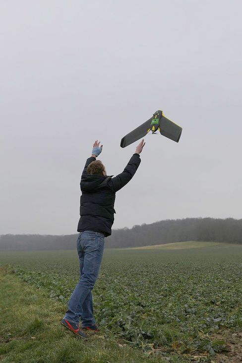 Drone operator Benjamin Bouly launches an eBee drone to collect crop data for Airinov.