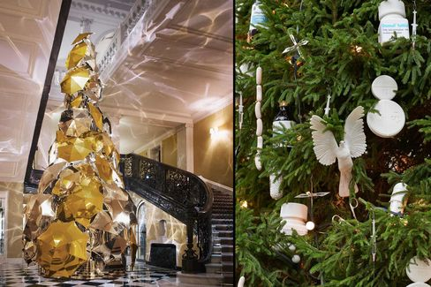 Claridge's 2015 Christmas tree designed by Burberry's Christopher Bailey (left). At the Connaught, Damien Hirst designed the ornaments.
