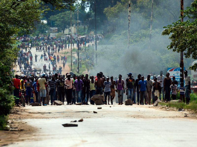 Protesters demonstrate against rising fuel prices near Harare in January.