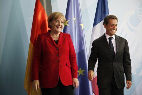Stocks Back Sarkozy in Euro Survival as Greece, Spain Surge