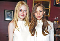 Dakota Fanning and Elizabeth Olsen attend the Very Good Girls official cast and filmmakers lunch