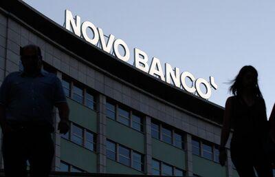 8c26636f3 An illuminated Novo Banco SA logo sits on a building near Marques de Pombal  square, Lisbon.