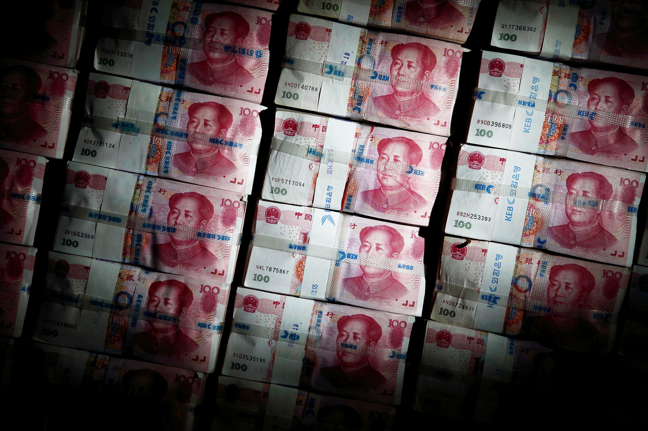 China Working Hard to Stabilize Yuan Against Basket, PBOC Says - Bloomberg