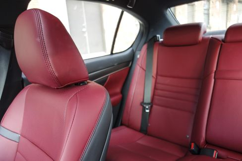 The interior of the GS 350 F Sport is spacious, and the red leather trim on the seats feels sufficiently supple.
