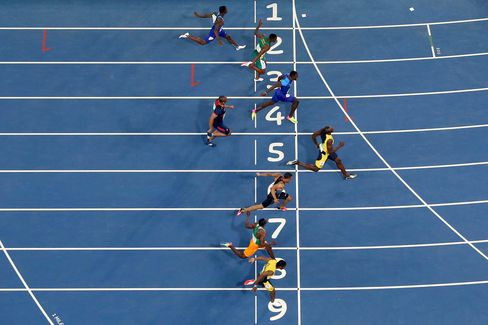 Usain Bolt crosses the finish line to win the Men's 100m Final.