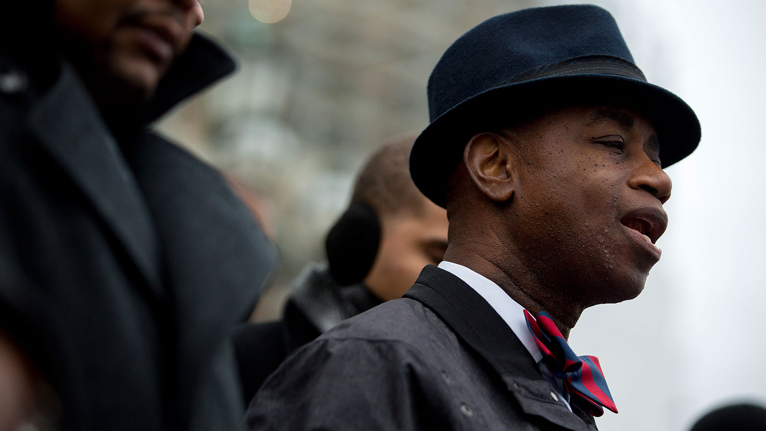 Senate Chaplain Dr. Barry Black leads a prayer during a protest with Congressional staff members on the U.S. Capitol steps in Washington on Dec. 11, 2014.
