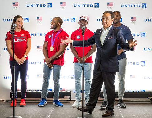 United Airlines CEO Oscar Munoz celebrates with Team USA in Houston before the athletes get ready to board their flight to Rio de Janeiro for the 2016 Summer Games on August 3.