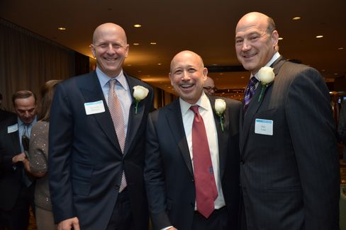 Lloyd Blankfein, CEO and chairman of Goldman Sachs Group Inc., center, with David Solomon, co-head of investment, left, and Gary Cohn, COO and president. Photographer: Amanda Gordon/Bloomberg