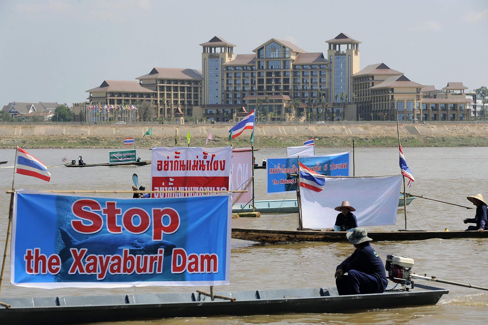Thai activists and villagers who are affected by the controversial Xayaburi dam protest with banners on the Mekong river in Nong Khai province, Thailand, in November 2012.