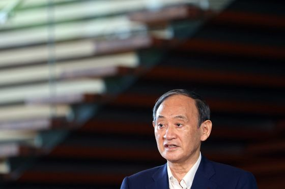 Japan's Suga Quits as Premier, Throwing Open Succession Race