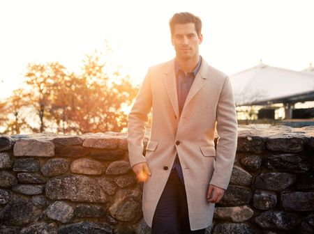 An unlined, cashmere topcoat such asthis one on Henrique by Theory will provide plenty of warmth without the weight. Plus, it's long enough to cover his suit jacket on game day but still short enough to allow him freedom of movement (of the off-duty variety).