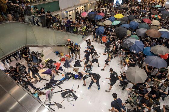 Dozens Arrested as Mass Hong Kong Rally Keeps Heat on Carrie Lam