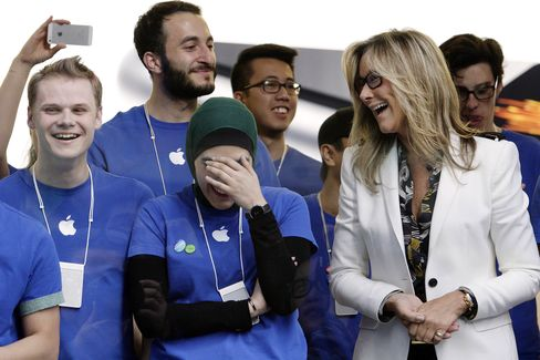 Angela Ahrendts interacts with employees.