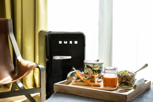 The hip Smeg refrigerators are stocked with healthy minibar options.