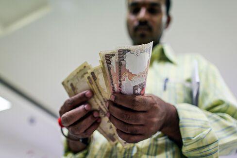 India's Rupee Plummets Past 68 to Record; Stocks, Bonds Tumble