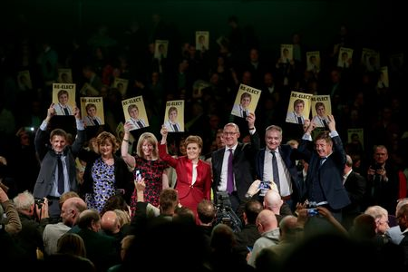 SNP leader and Scotland's First Minister Nicola Sturgeon stands with members of the Scottish Cabinet at an event launching the SNP's election manifesto in Edinburgh.