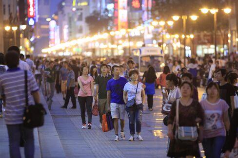 China's Economy Grew 7.4% in Third Quarter Vs 7.4% Estimate