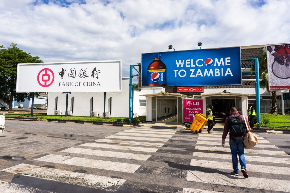 A Bank of China billboard greets travelers at the airport in Lusaka.