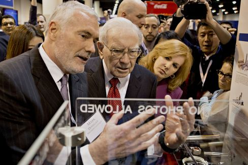 Buffett speaks with Donegan as they tour the exhibition floor during the Berkshire Hathaway Inc. annual shareholders meeting in Omaha, Nebraska this year.