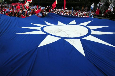 A large Taiwanese flag is seen at a camp