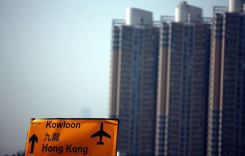Residential buildings stand in the Kowloon region
