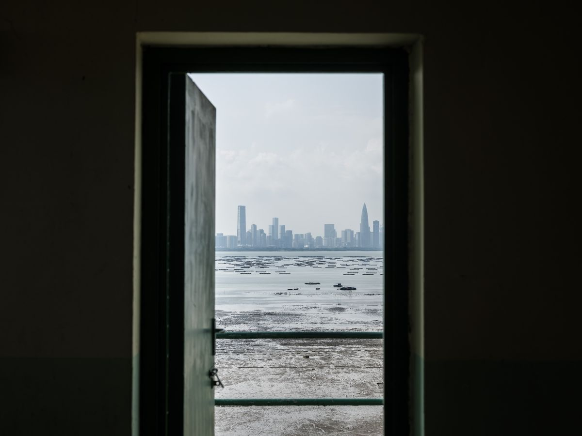 View of Shenzhen's skyline through a door from Hong Kong