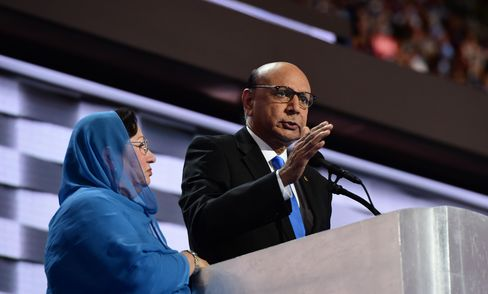Khizr Khan, accompanied by his wife, Ghazala, speaks about their son, U.S. Army Captain Humayun Khan, who was killed by a suicide bomber in Iraq 12 years ago, on the final night of the Democratic National Convention on July 28, 2016, in Philadelphia.