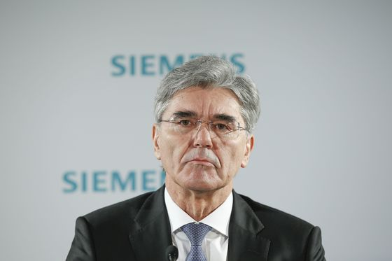 Siemens CEO Faces Down Protesters, Signals Tough Year Ahead