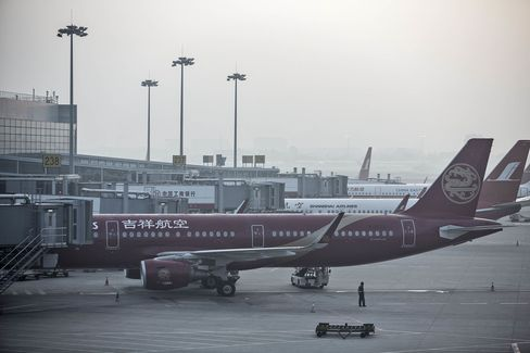 Airplanes ready to fly at Shanghai's Hongqiao Airport. With passenger numbers in China increasing 11 percent last year, carriers are scheduling more flights to handle demand.