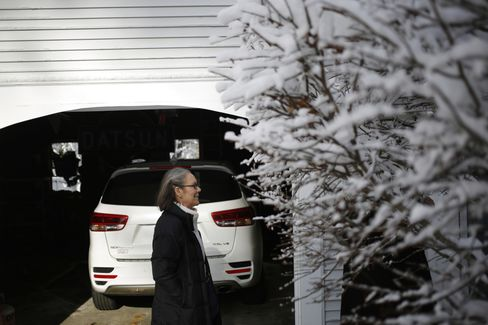 Catherine Johnson waits to speak with a homeowner after knocking on a door for Chris Christie in Hollis, New Hampshire, on Feb. 6, 2016.