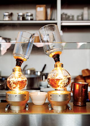 "Siphon brewing makes a ""delicate, tea-like cup of coffee,"" says Blue Bottle"