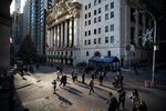Pedestrians pass in front of the New York Stock Exchange (NYSE) in New York, U.S.