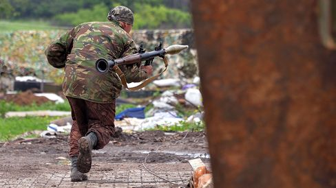 A Ukrainian serviceman prepares to fire a grenade launcher on positions on the frontline of fighting against pro-Russian separatists near Donetsk on May 30, 2015 in eastern Ukraine.