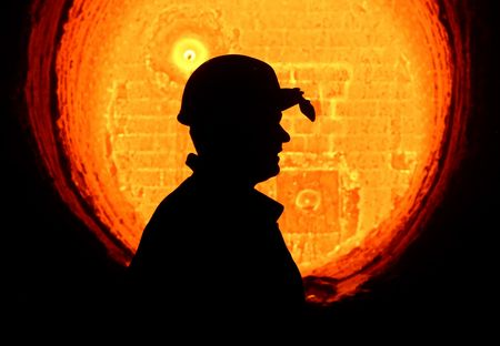 A worker passes a red hot furnace at the OAO Izhstal steel plant in Izhevsk, Russia.