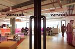 Signage is displayed on glass doors at the WeWork Cos. 32nd Milestone co-working space in Gurugram, India, on Monday, Feb. 18, 2019.