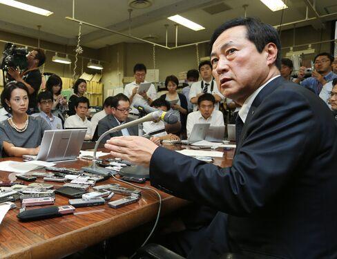 Mizuho President Yasuhiro Sato