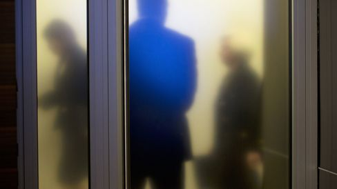 Federal Reserve Chair Janet Yellen, right, walks past a frosted glass door as she arrives to speak at a news conference in Washington, on Sept. 17, 2015.