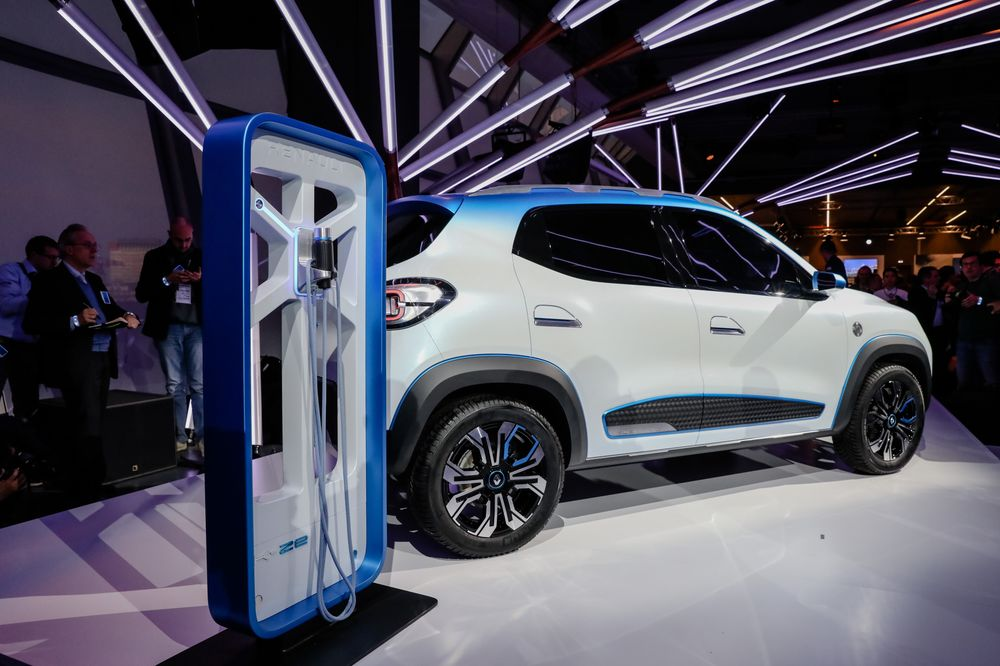 An Electric Charging Station Stands Beside A Renault Sa K Ze Suv
