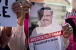 A Codepink demonstrator holds a photograph of journalist Jamal Khashoggi outside the White House in Washington on Oct. 19.
