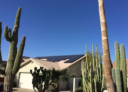 Roof solar panels on a residence in Mesa, Ariz.