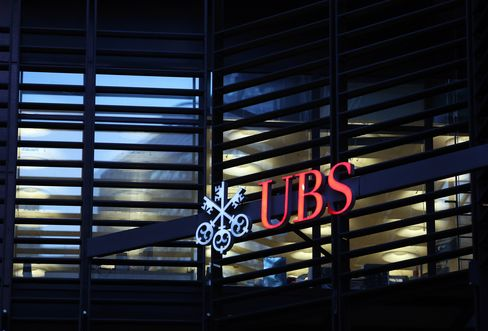 A Sign Sits Outside UBS's Offices in London