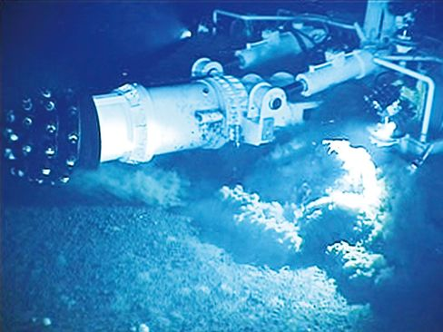 A mining equipment scours the seabed for minerals.